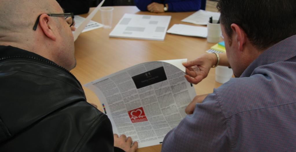 Volunteers examine the projects first prototype1