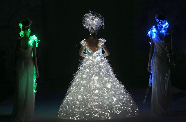 A model showcases a wedding dress that lights up
